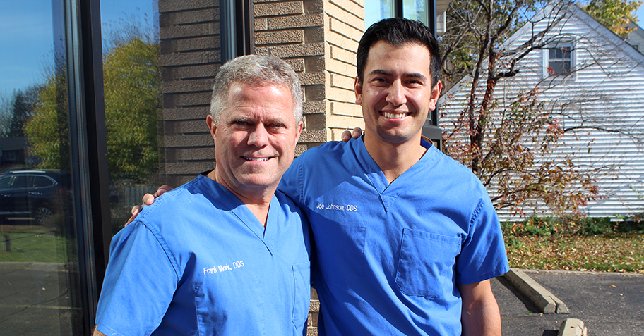 Doctor Frank and Doctor Johnson posing together outside dentist office in Richfield, MN